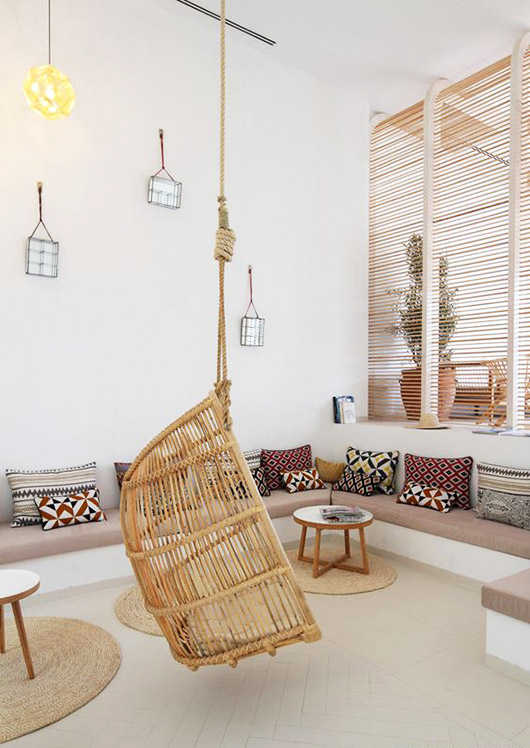 built-in bench and hanging wicker chair. / sfgirlbybay