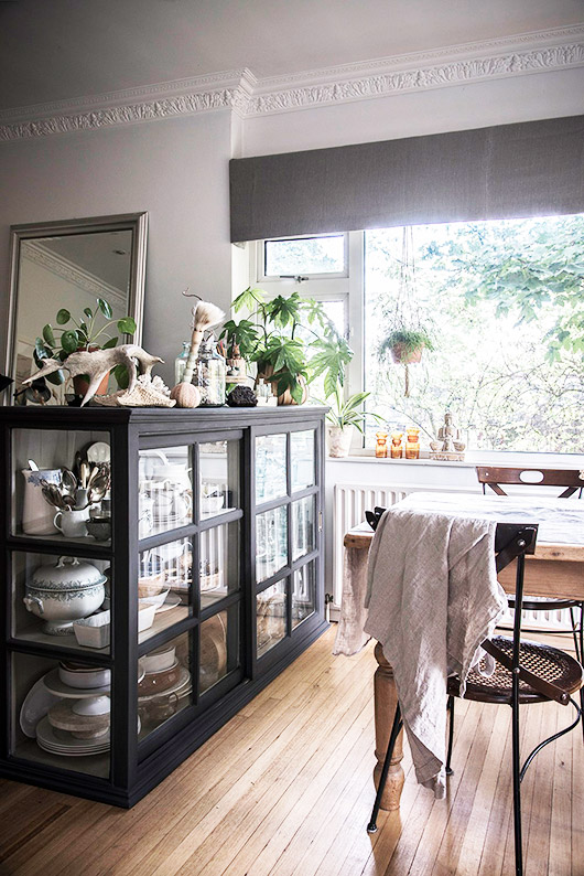 dining room with crown molding and black cabinet. / sfgirlbybay
