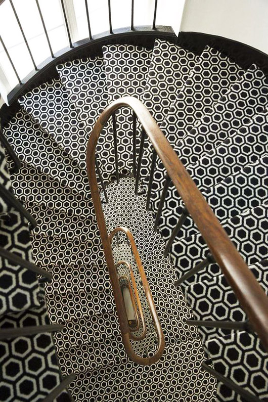 black and white hexagon staircase with wood railing. / sfgirlbybay