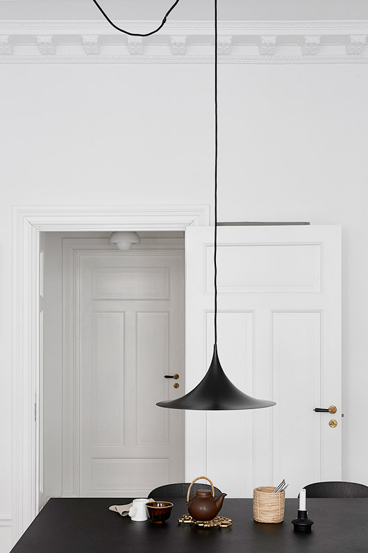 blank hanging lamp over black dining table via fantastic frank. / sfgirlbybay