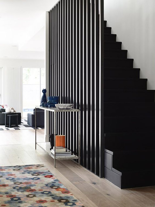 slatted black wall and staircase. / sfgirlbybay