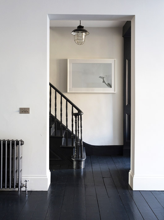 painted black staircase and floors. / sfgirlbybay