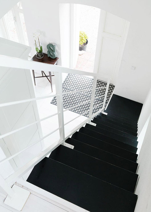 black stairs with white railing and walls. / sfgirlbybay