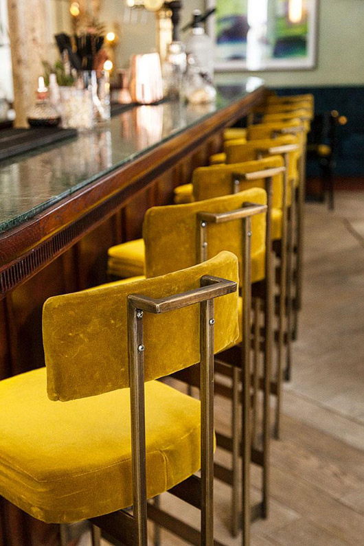 gold bar stools at maison lautrec in paris. / sfgirlbybay