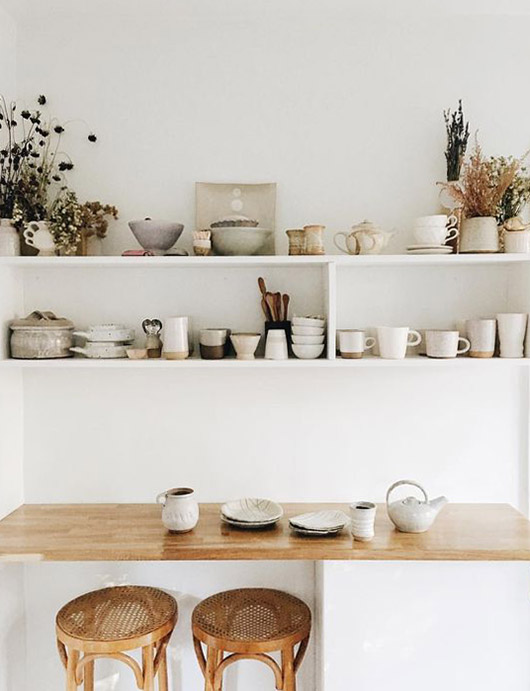 open white shelving with ceramic dishes. / sfgirlbybay
