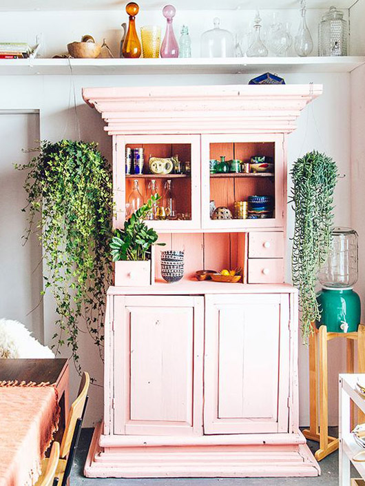 pink cabinet with green hanging plants. / sfgirlbybay