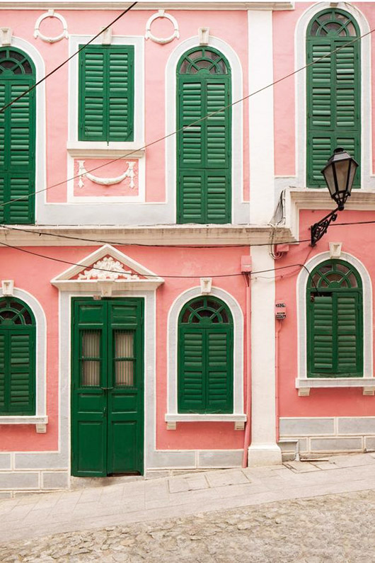 green shutters and door on pink building with white trim. / sfgirlbybay