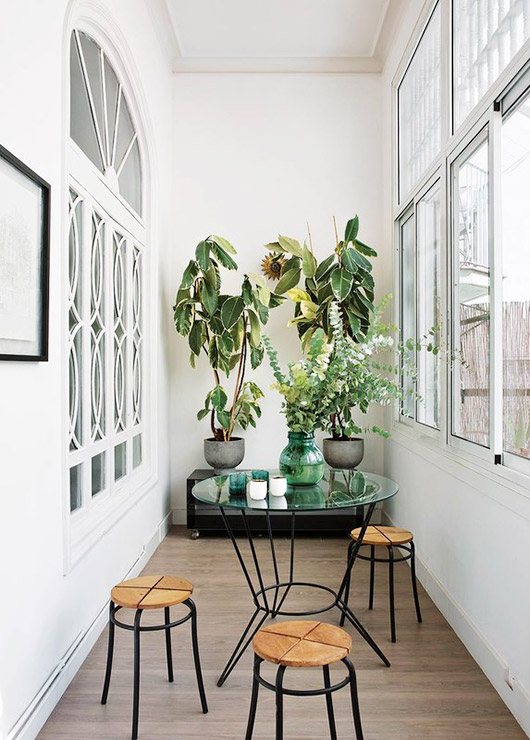 green potted plants and modern table with stools. / sfgirlbybay