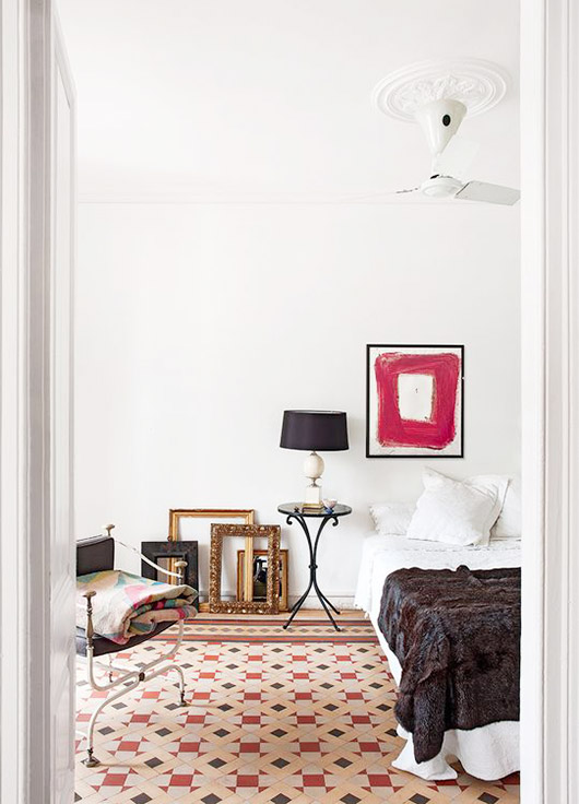 bedroom with tile floors and white walls. / sfgirlbybay
