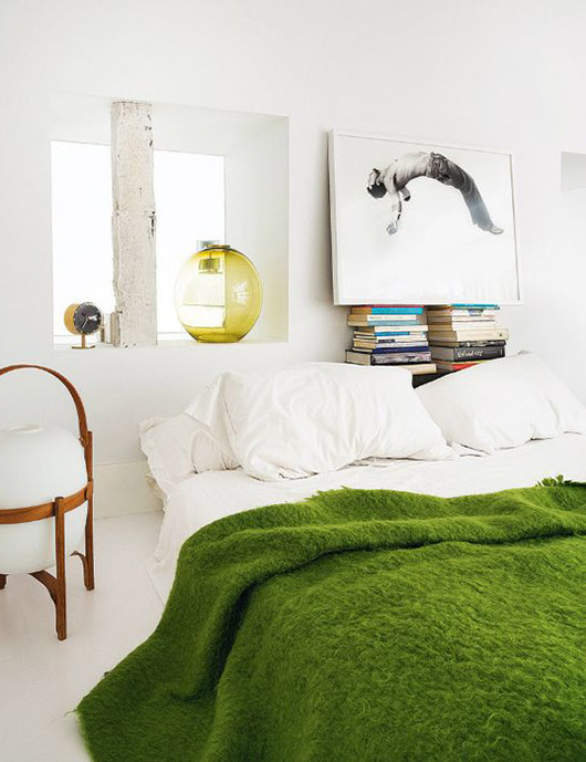 green blanket on white bed. / sfgirlbybay