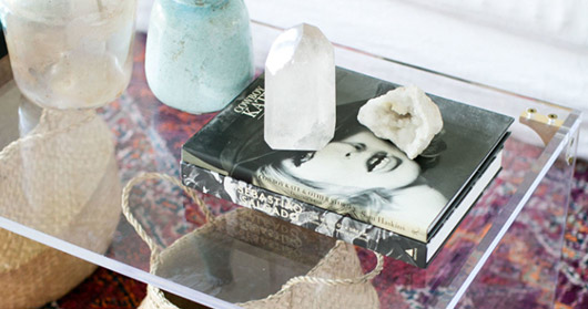 lucite coffee table with books and geodes. / sfgirlbybay