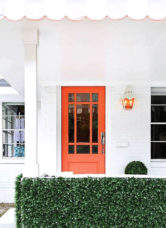 white house with orange door. / sfgirlbybay