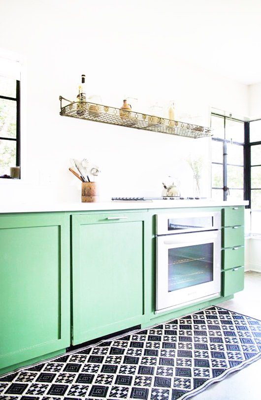 green kitchen cabinetry and floating vintage gold shelf. / sfgirlbybay