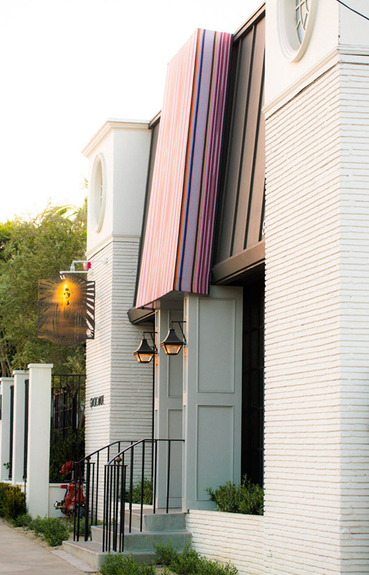 white exterior with colorful awning at gracias madre. / sfgirlbybay