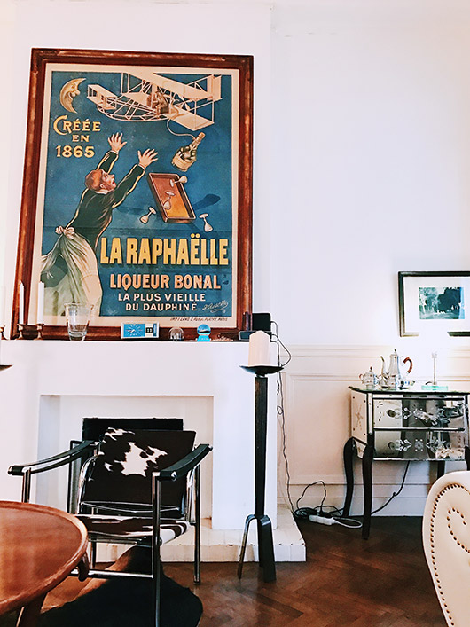 oversized vintage french poster on mantle at pension edelweiss. / sfgirlbybay