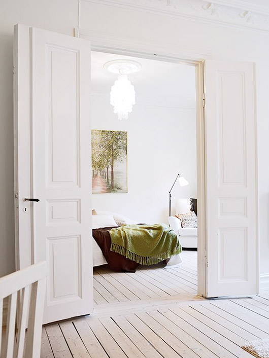 whitewashed floors and white walls with white double-doors. / sfgirlbybay