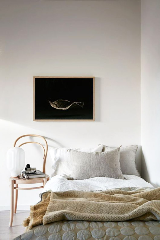 minimalist bedroom with framed art over the bed. / sfgirlbybay