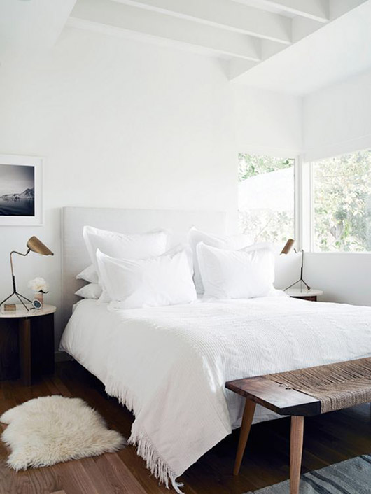 modern bedroom with white walls and bedding. / sfgirlbybay