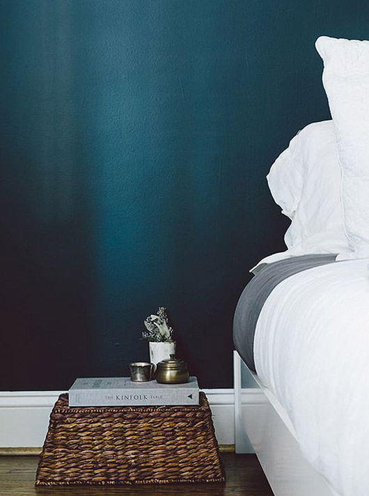blue bedroom wall with white and gray bedding. / sfgirlbybay