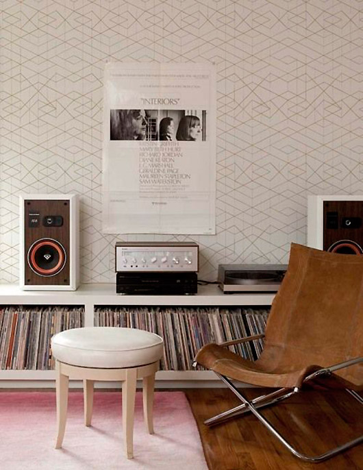 listening area with pink area rug and vintage poster. / sfgirlbybay