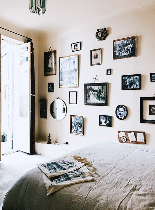 white wall with vintage black and white portraits at maison empereur. / sfgirlbybay