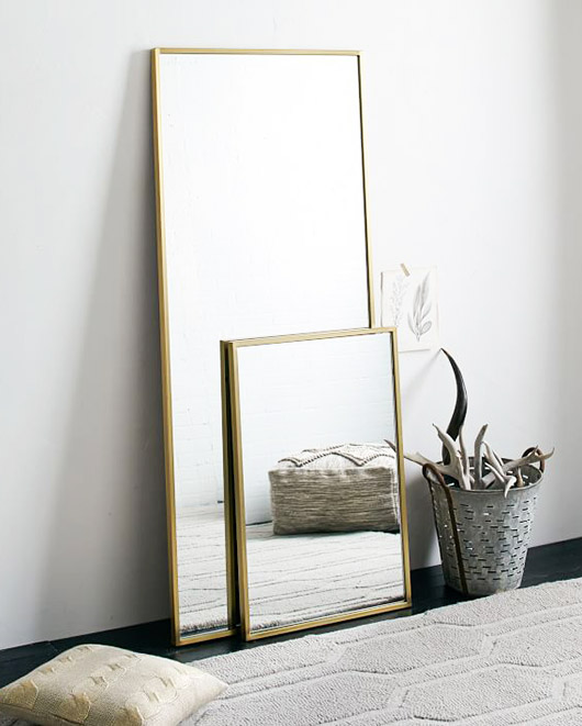 gold framed mirrors. / sfgirlbybay
