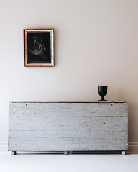dark painting in gold frame in minimalist space. / sfgirlbybay