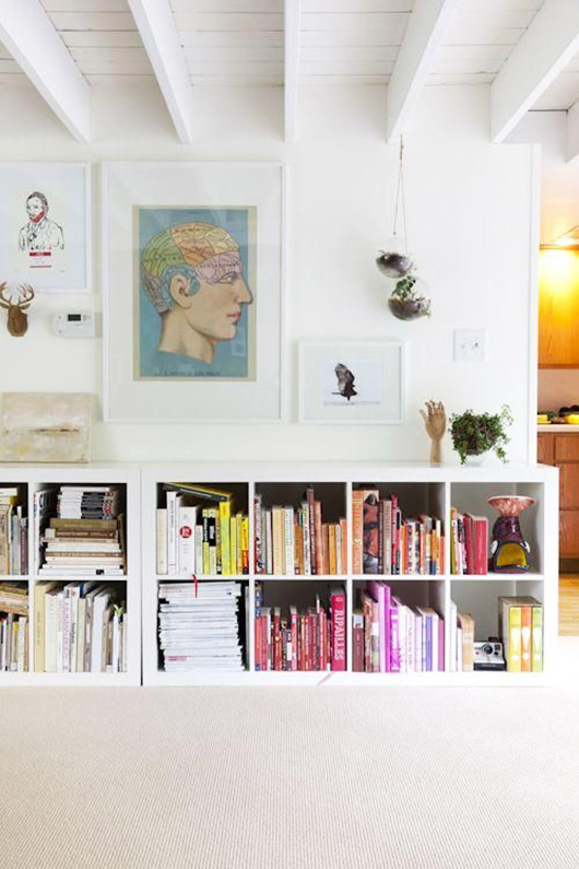 white living room with color blocked bookcase. / sfgirlbybay