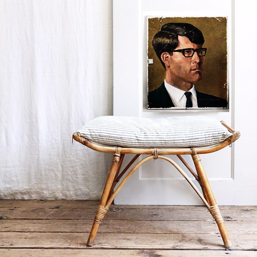 vintage portait painting and rattan stool. / sfgirlbybay