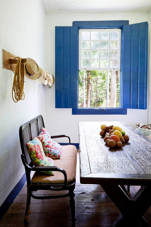 dining area with blue shutters. / sfgirlbybay