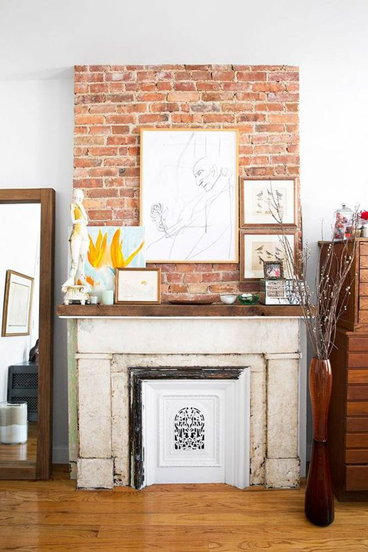 art and decor on mantel with exposed brick. / sfgirlbybay