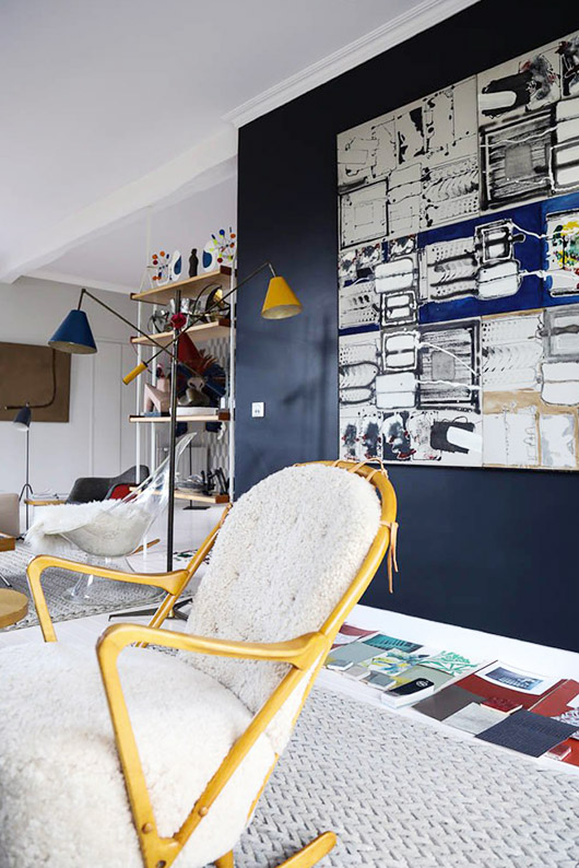 dark blue living room wall with oversized painting. / sfgirlbybay