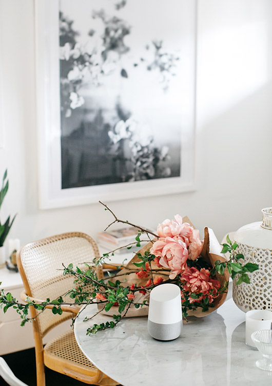google home on dining room table with flowers. / sfgirlbybay