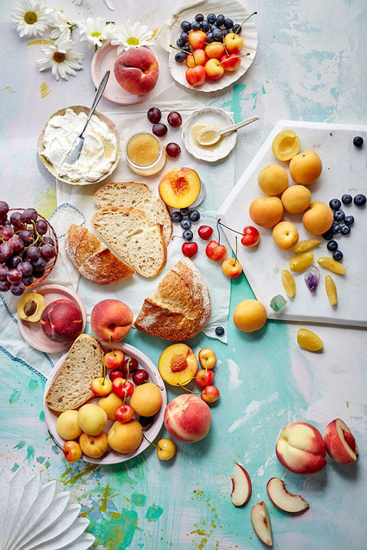 colorful food styling with assorted fruits, bread and spreads. / sfgirlbybay