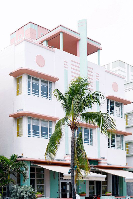 art deco building with green palm tree. / sfgirlbybay