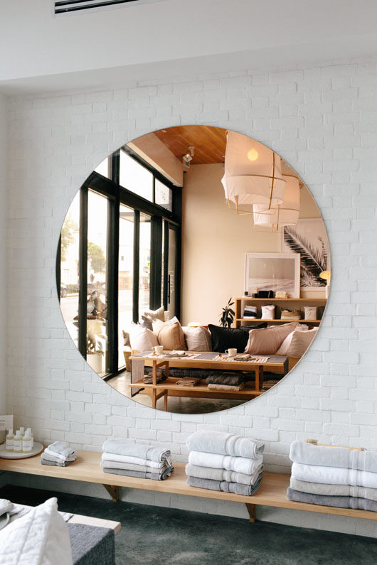 large copper mirror at parachute home. / sfgirlbybay