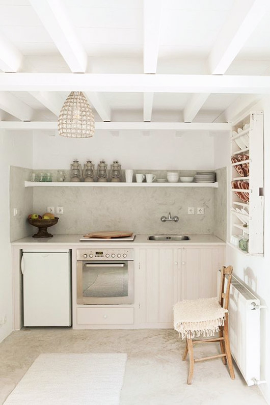 little white kitchen with beamed ceilings. / sfgirlbybay