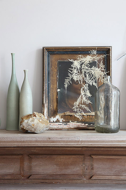 art and vases on mantle styled by light locations. / sfgirlbybay