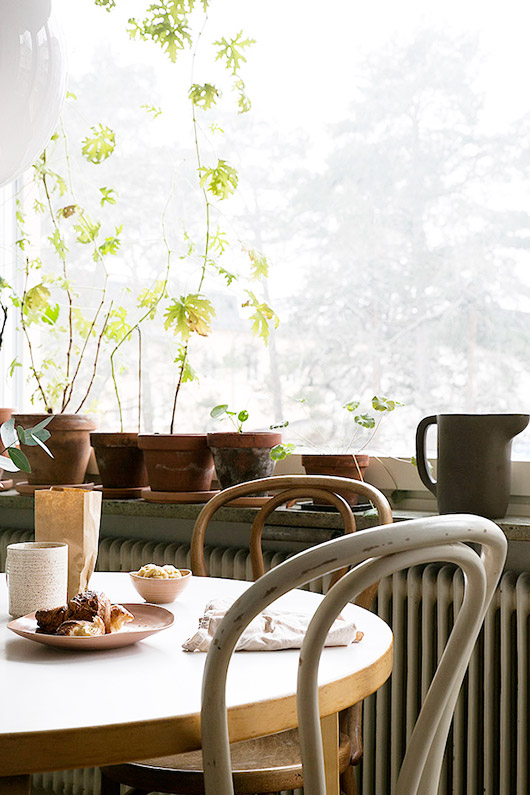 painted and natural bentwood chairs. / sfgirlbybay