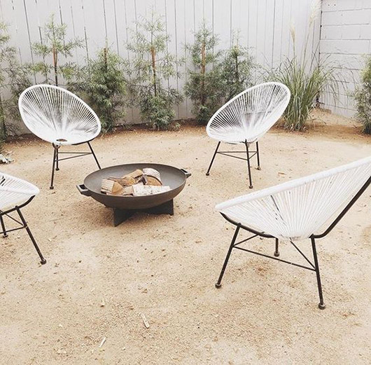 vinyl acapulco chairs around modern fire pit. / sfgirlbybay