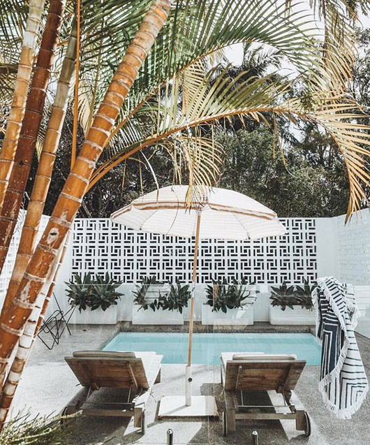 poolside tilework and palm trees. / sfgirlbybay