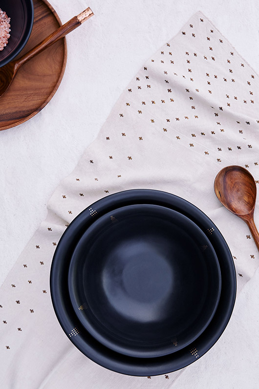 black ceramic dishes with gold dot decals. / sfgirlbybay