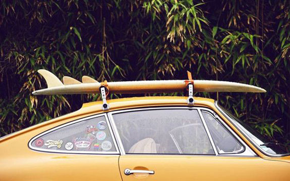 yellow car with surf rack. / sfgirlbybay
