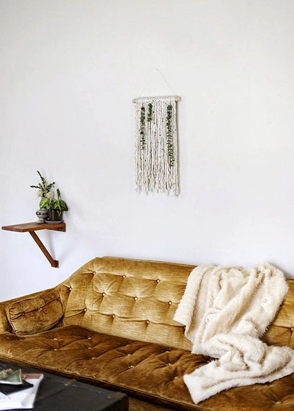 wall hanging over golden velvet sofa. / sfgirlbybay