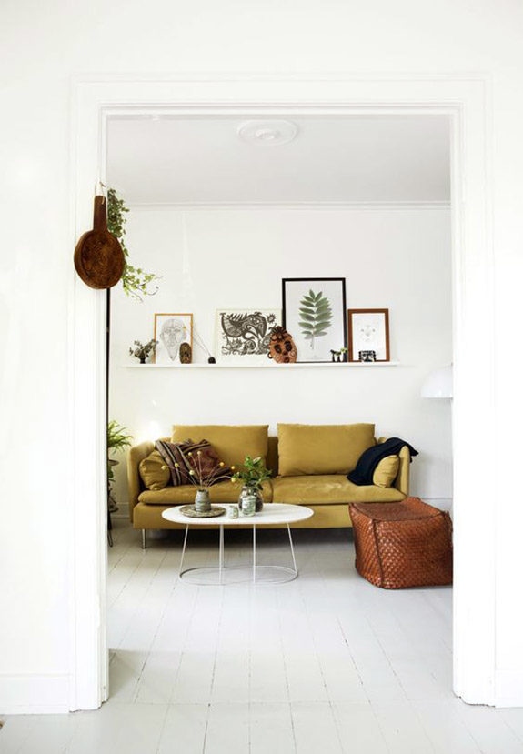 white walls and golden yellow sofa. / sfgirlbybay
