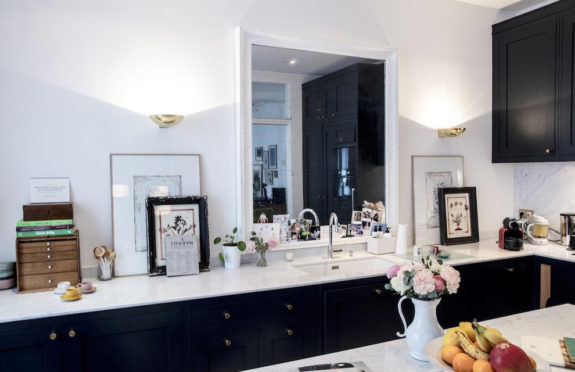 black and white kitchen with marble countertops in home of Morgane Sézalory, Sézanefashion boutique founder. / sfgirlbybay