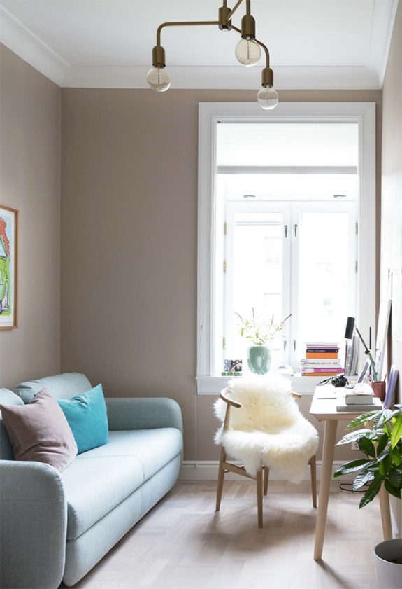tan walls and pastel blue sofa in modern apartment in oslo. / sfgirlbybay