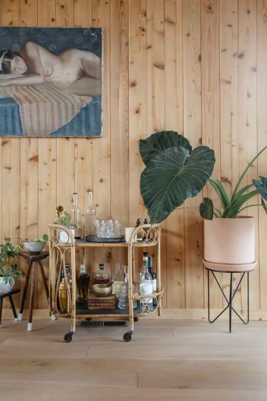 rattan bar cart and modern plant stand in malibu hills home. / sfgirlbybay