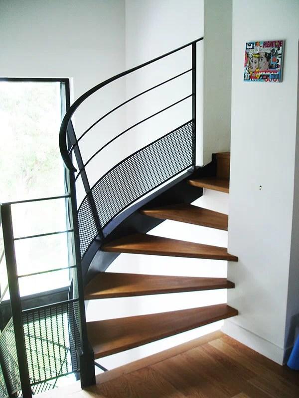Escaliers tournant avec palier bois et metal