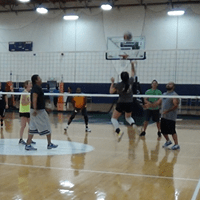 Indoor volleyball player attacking the ball